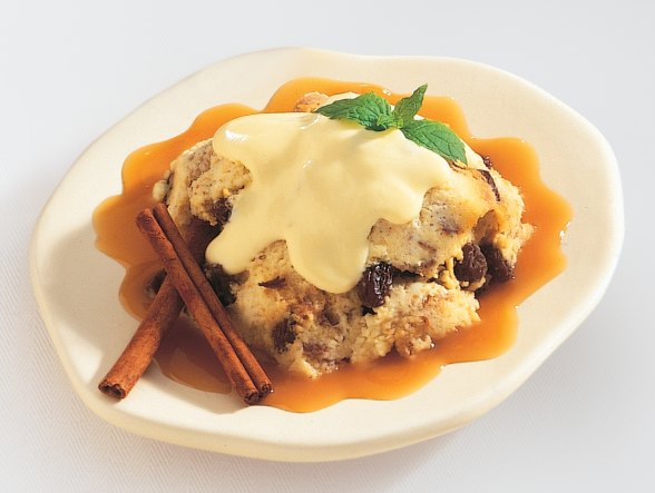 Cinnamon Raisin Bread Pudding with Vanilla Rum Sauce